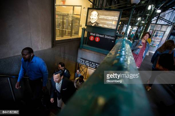 Commuters exit the Wall Street subway station near the New York Stock Exchange in New York US on Friday Sept 8 2017 The dollar fell to the weakest in...