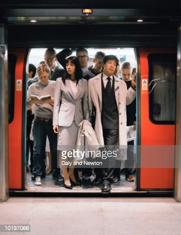 Commuters exiting underground train : Stock Photo