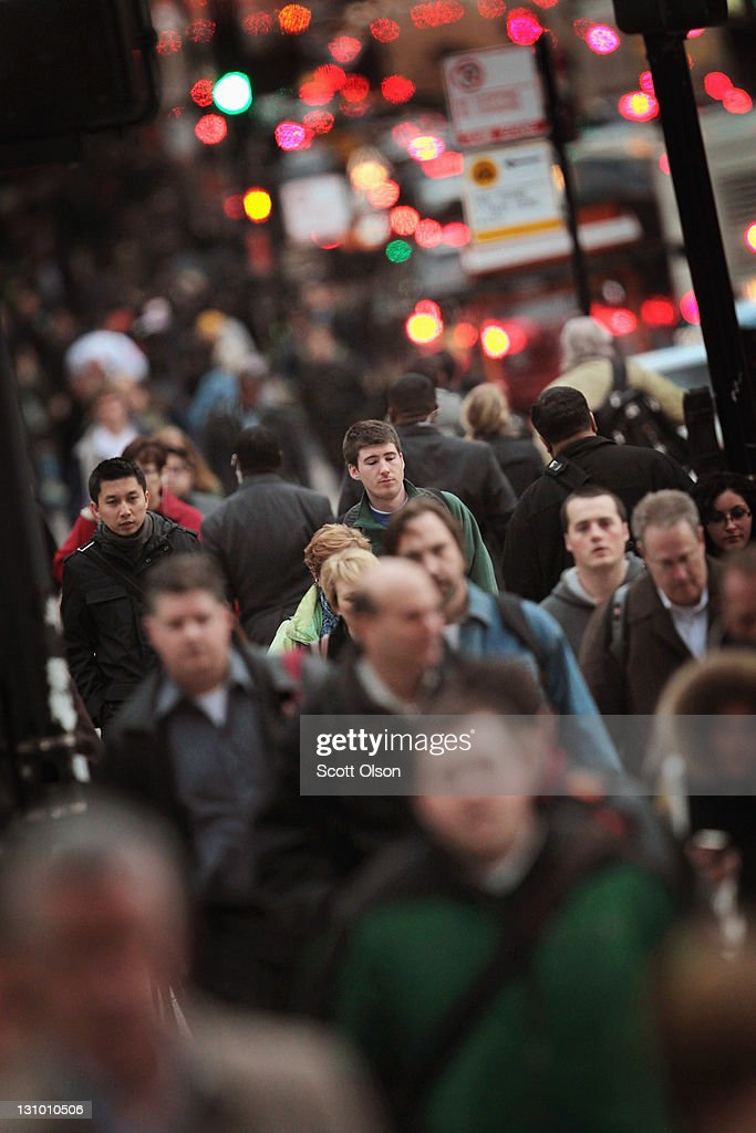 Commuters fill the sidewalk as they make their way toward the train station on October 31, 2011 in Chicago, Illinois. The United Nations Population Fund estimates that today the world's population reached seven billion people. The U.N. also estimates the world's population will reach eight billion by 2025 and 10 billion by 2083.