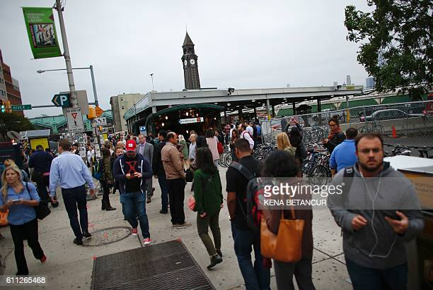 Commuters gather at New Jersey Transit's rail station in Hoboken New Jersey September 29 2016 A commuter train crashed into a station in New Jersey...
