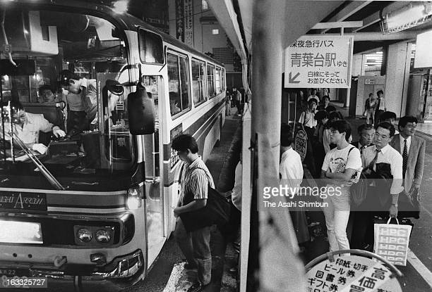Commuters get on a night bus at Shibuya Station on September 21 1989 in Tokyo Japan A large scale redevelopment around Shibuya station is scheduled...