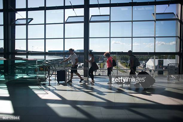 Commuters heading towards their fights from the Metro in Copenhagen Airport Copenhagen Denmark 21st of August 2016