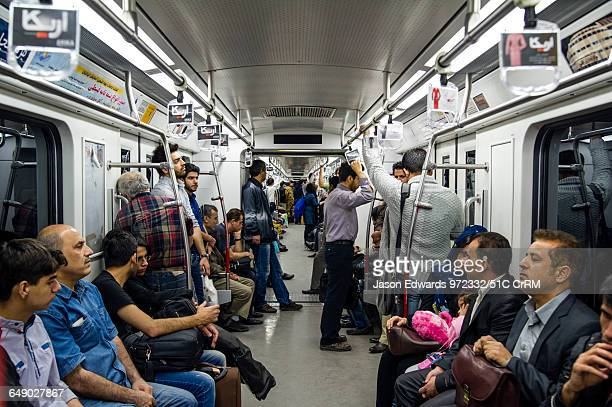 Commuters in a train carriage in a railway subway system beneath Tehran