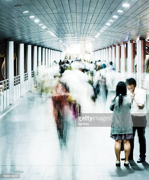Commuters in Bangkok train station, Thailand