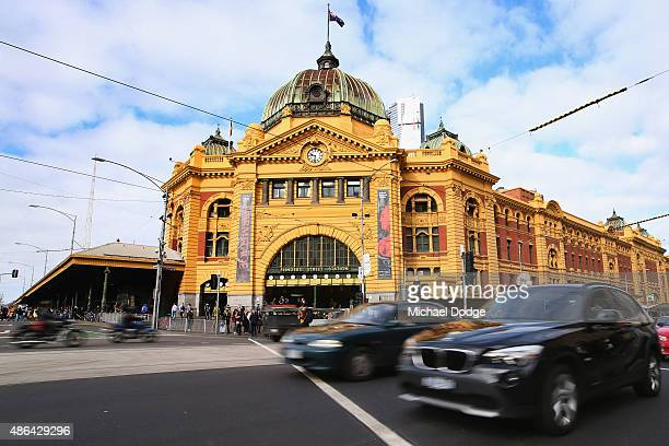 Commuters in cars drive past Flinders Street Train Station shortly before Train Union workers start their strike on September 4 2015 in Melbourne...