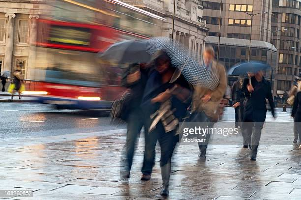 Commuters in the Rain in London with movement blur