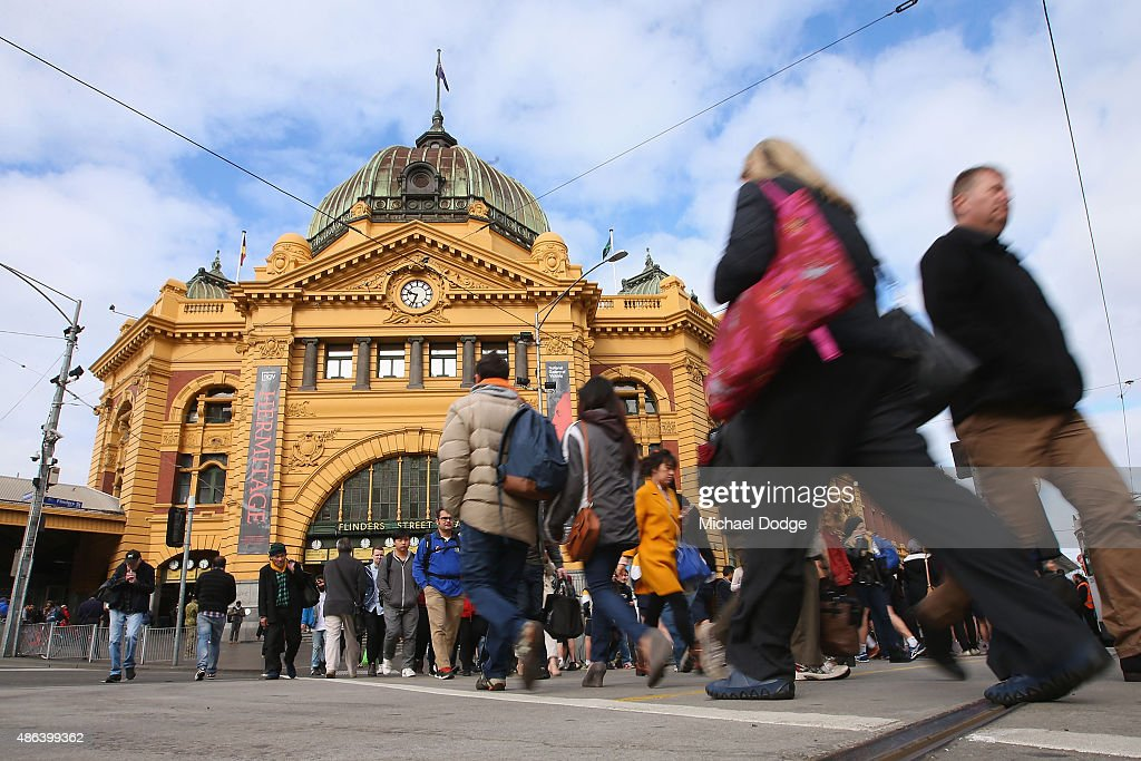 Commuters leave and arrive at Flinders Street Station shortly before Train Union workers start their strike on September 4 2015 in Melbourne...