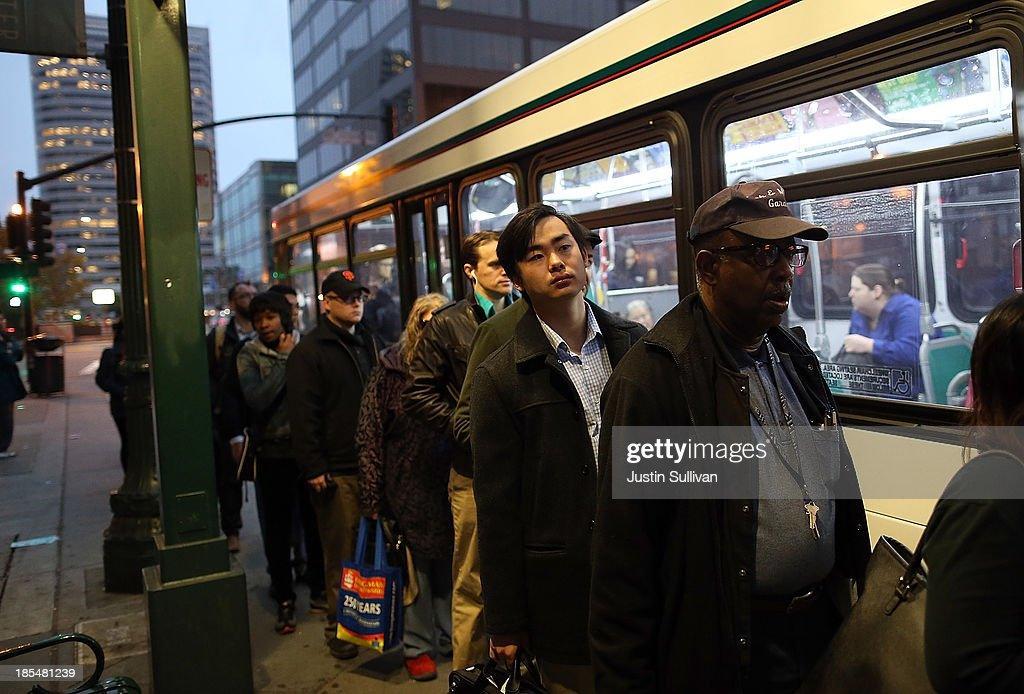 Commuters line up to board an AC Transit bus on October 21, 2013 in Oakland, California. BART workers continue to strike after contract negotiations between BART management and the transit agency's two largest unions fell apart last week. Management and unions agreed on the financial specifics of the contract but differed on workplace safety rules. An estimated 400,000 commuters ride BART each day.