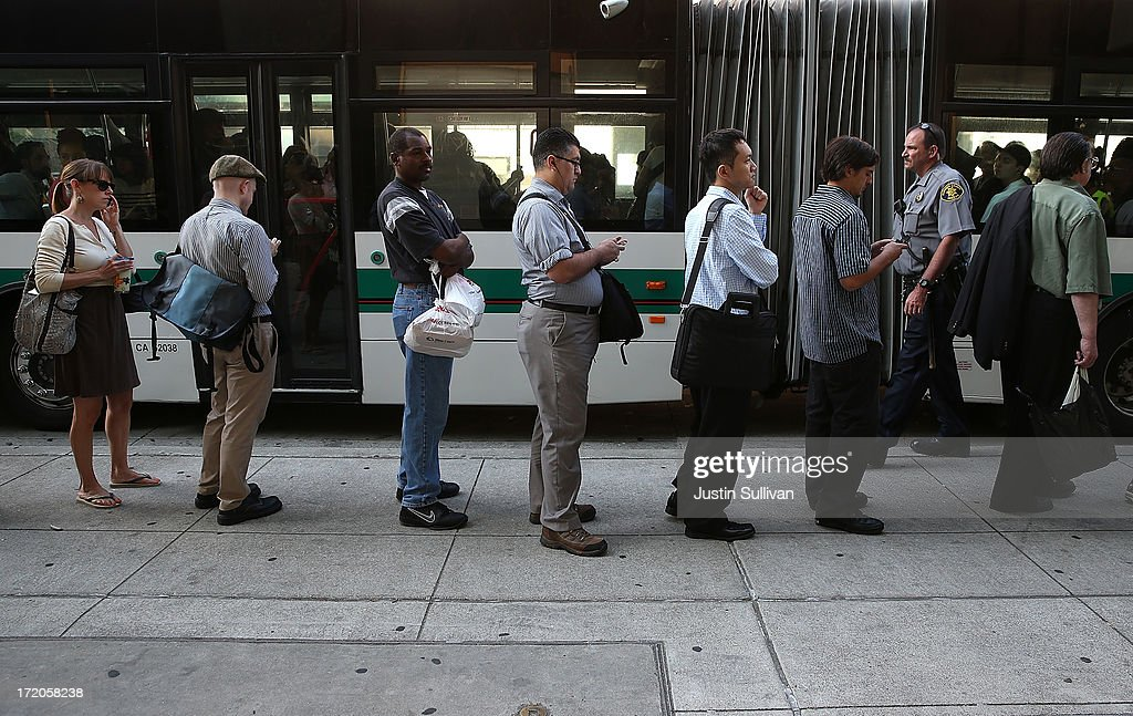 Commuters line up to wait for an AC Transit bus on July 1, 2013 in Oakland, California. Hundreds of thousands of San Francisco Bay Area commuters are scrambling to find ways to work after the Bay Area Rapid Transit (BART) workers from the Amalgamated Transit Union Local 1555 went on strike at midnight after contract negotiations with management fell apart on Sunday. Train operators, mechanics, station agents and maintenance workers are seeking a five percent wage increase and are fighting management who want to have workers to begin contributing to their pensions, pay more for health insurance and reduce overtime expenses.
