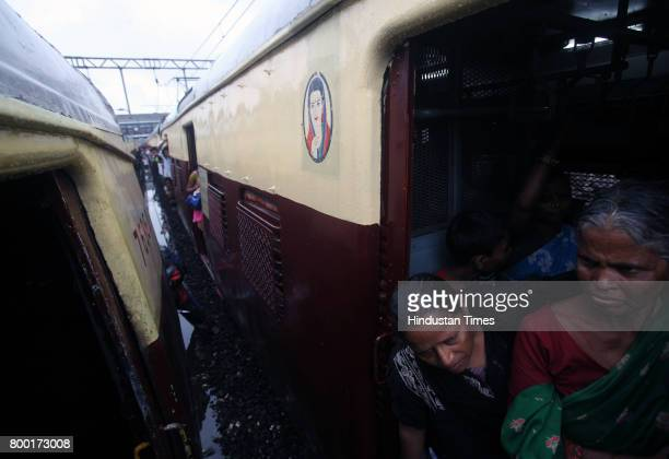 Commuter's look at derailed local train at Reay Road on Tuesday in Mumbai