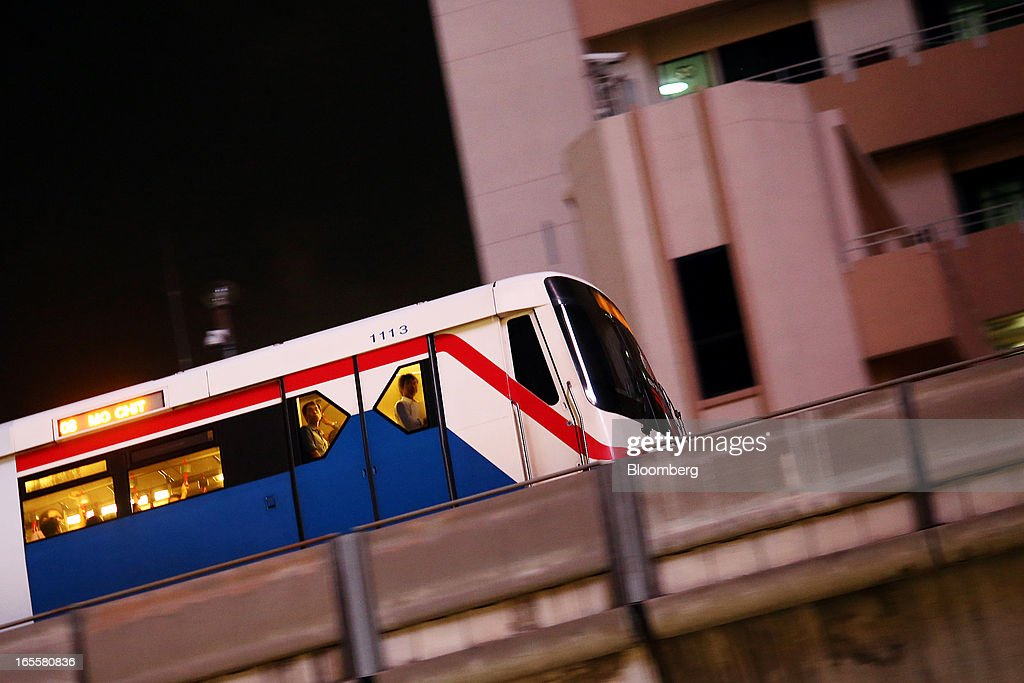 Commuters look out from windows on a Bangkok Mass Transit System Pcl SkyTrain, a unit of BTS Group Holdings Pcl, as it travels on an elevated track above the Rachadamnoen intersection at night in central Bangkok, Thailand, on Thursday, April 4, 2013. The BTS Rail Mass Transit Growth Infrastructure Fund, backed by Bangkok's SkyTrain, raised about 62.5 billion baht ($2.1 billion) in Thailand's biggest initial public offering. Photographer: Dario Pignatelli/Bloomberg via Getty Images