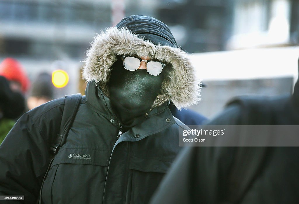 Commuters make a subzero trek to offices in the Loop on January 6 2014 in Chicago Illinois Temperatures in the city dipped to 16 degree Fahrenheit...