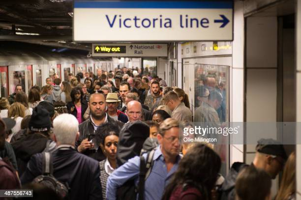 Commuters make their way down a crowded platform on the underground at Victoria Station during rush hour on day two of a planned 48 hour underground...
