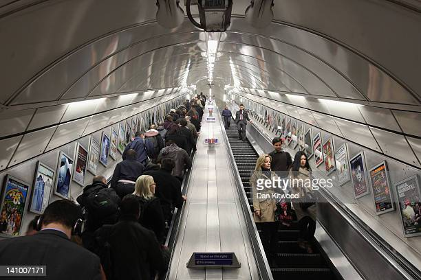 Commuters make their way on the escalator at Angel underground station on March 5 2012 in London England The escalators at Angel tube station are the...