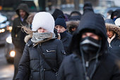 Commuters make their way to work as temperatures hovered around zero degrees Fahrenheit during the morning rush on January 5 2015 in Chicago Illinois...
