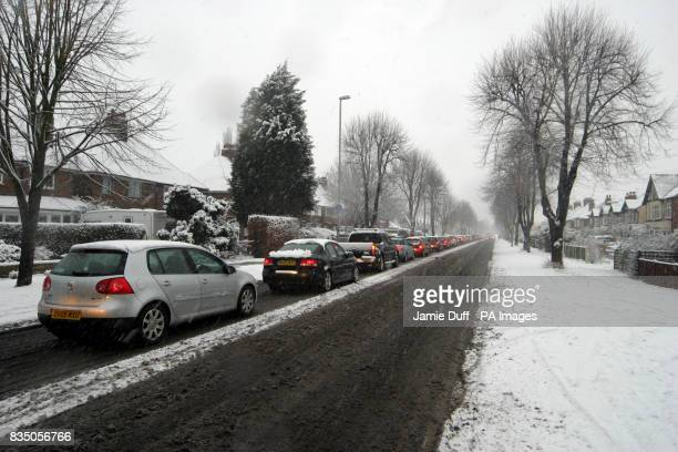 Commuters make their way to work in Chilwell Nottinghamshire as heavy snowfall hits parts of the UK