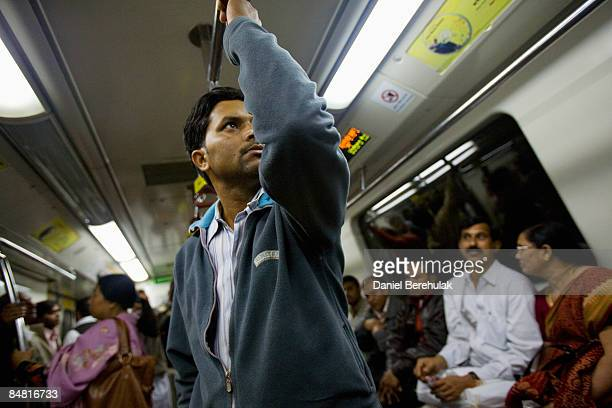 Commuters on board a train on a section of the newly completed Metro on February 16 2009 in Delhi India Parts of the capital's metro system have gone...
