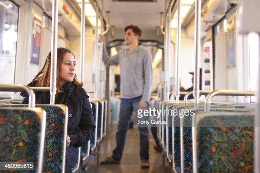 Commuters on empty subway train