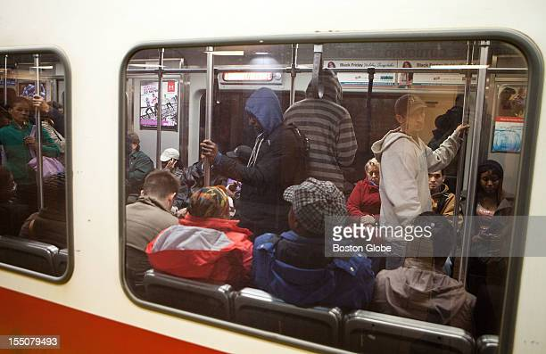 Commuters packed in the Red Line T train are seen in South Station on Monday October 29 2012 The MBTA commuter train in Boston Massachusetts was...