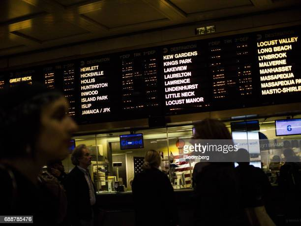 Commuters pass in front of the ticket counter at the Long Island Railroad Co concourse inside Pennsylvania Station in New York US on Friday May 26...