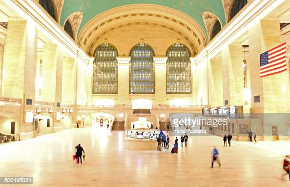 Commuters pass through Grand Central Terminal on January 23 2016 in New York City The MetroNorth train lines ceased operation at 4 pm for the day The...