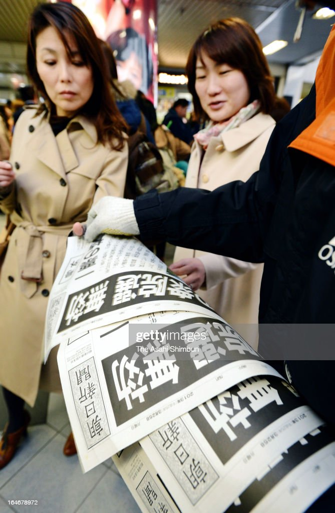 Commuters pick up the extra edition on March 25, 2013 in Tokyo, Japan. In a landmark decision, the Hiroshima High Court ruled on March 25 that the results of the Dec. 16 Lower House election in two constituencies were invalid due to the wide gap in the value of votes.