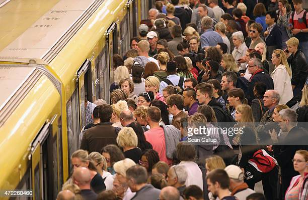 Commuters prepare to board an UBahn metro train at Alexanderplatz station on the first full day of a weeklong nationwide rail strike by the GDL train...