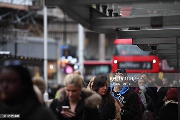 Commuters queue at Victoria bus station in central London on January 9 2017 A strike on the London Underground caused major disruption on January 9...