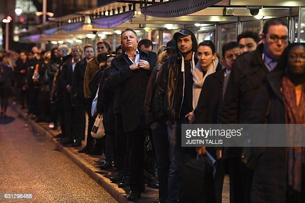 Commuters queue at Victoria bus station in central London on January 9 2017 during a 24hour tube strike A strike on the London Underground caused...
