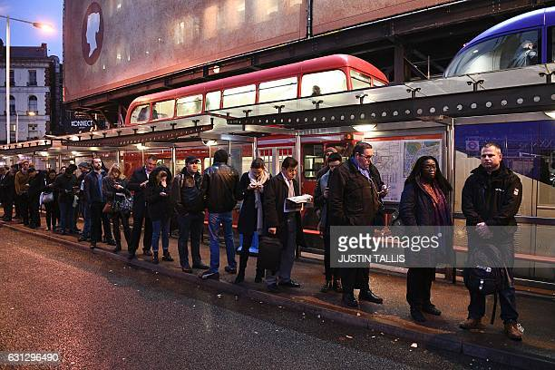 TOPSHOT Commuters queue at Victoria bus station in central London on January 9 2017 during a 24hour tube strike A strike on the London Underground...