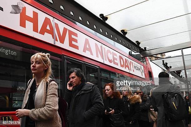 Commuters queue to board a bus at Victoria bus station in central London on January 9 2017 during a 24hour tube strike A strike on the London...