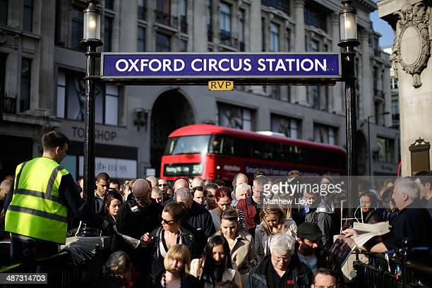 Commuters queue to enter Oxford Circus tube station which is running a limited service on April 29 2014 in London England Union members are striking...