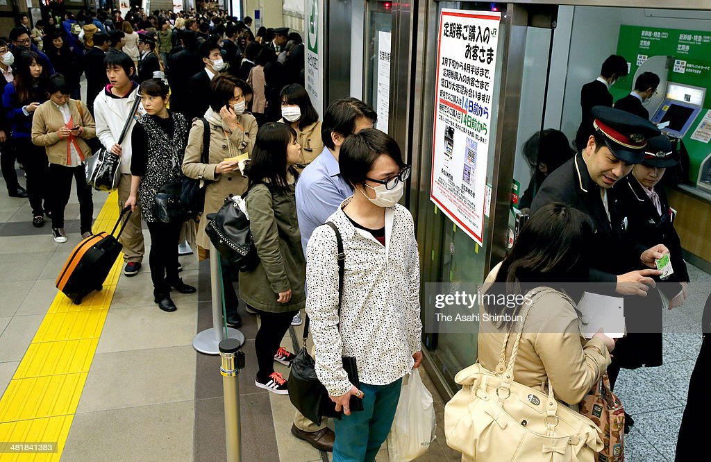 Commuters queue to renew their season tickets before the new 8 percent tax rate applied at JR Shinjuku Station on March 31, 2014 in Tokyo, Japan. Japan raises consumption tax from 5 to 8 percent on April 1, and possibly to 10 percent in October 2015, despite market concerns about a slowing of the economic recovery.