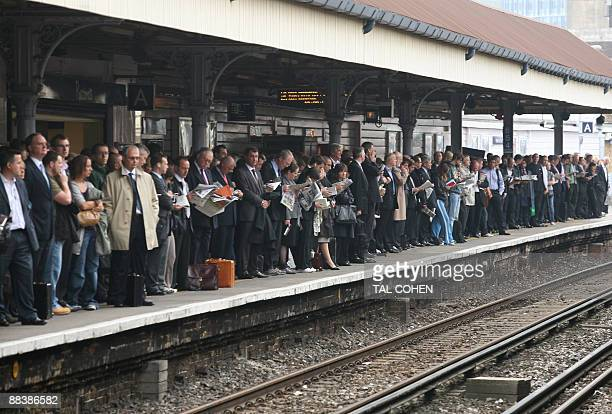 Commuters queue wait for trains at Waterloo station in central London on June 10 as an underground train strike grips the city Millions of London...