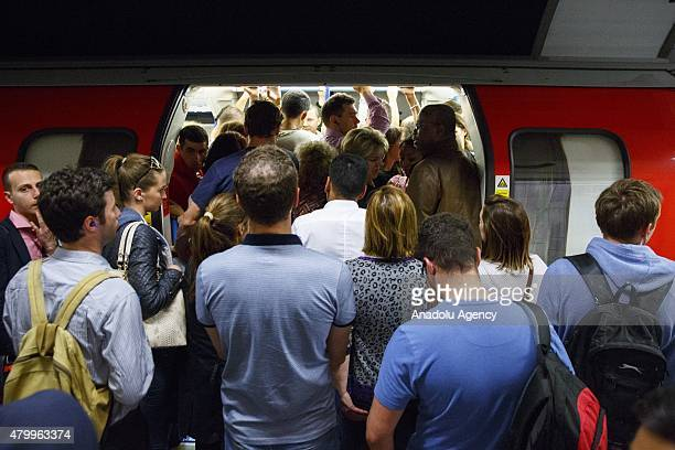 Commuters queuing for tube trains at Green Park Tube Station ahead of the tube strike in evening rush hour of July 8 2015 in London England The...