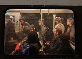 Commuters ride a Metrorail train at Union Station March 15 2016 in Washington DC Metrorail announced today that they will shut down service entirely...
