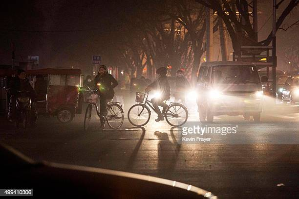 Commuters ride bicycles in smog during a day of high pollution on December 1 2015 in Beijing China China's capital and many cities in the northern...