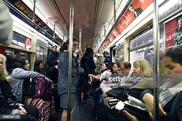 Commuters ride on a subway train in New York on September 25 2014 Iraq's Prime Minister Haider alAbadi who is attending the 69th session of the...