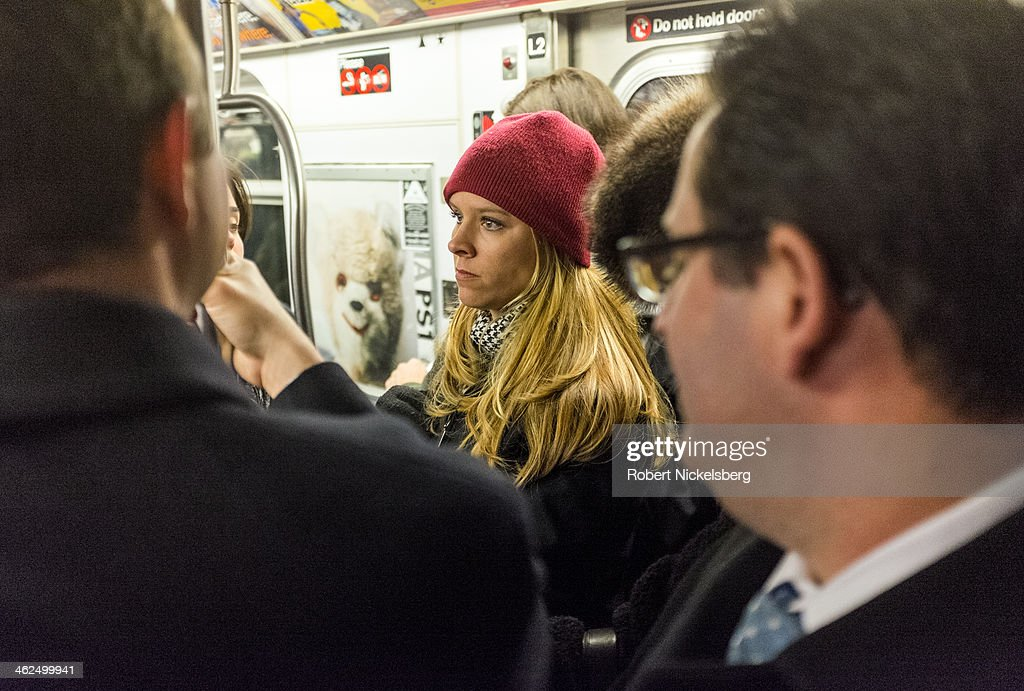 Commuters ride the subway during rush hour December 12, 2013 in the Manhattan borough of New York.
