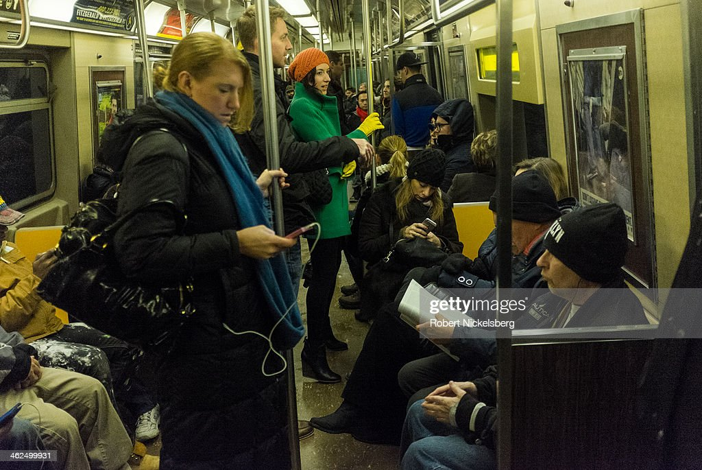 Commuters ride the subway during rush hour December 14, 2013 in the Brooklyn borough of New York.