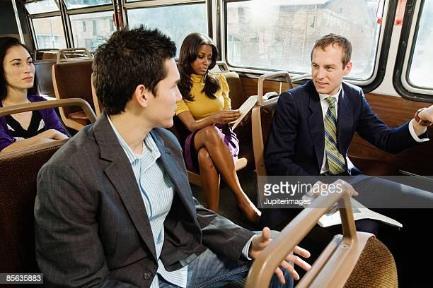 Commuters riding bus