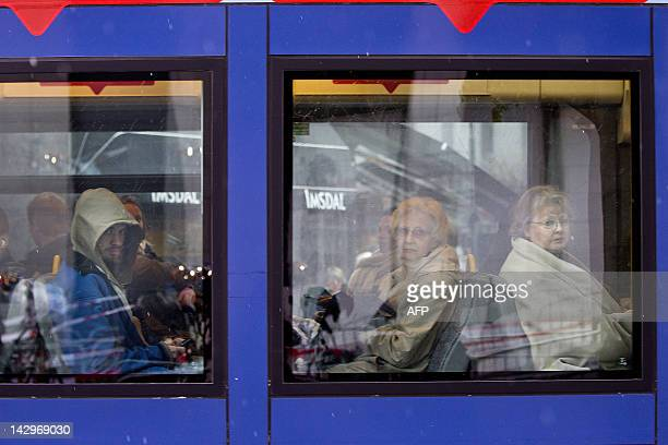 Commuters sit in a tram as it rides past the Oslo court house on April 16 2012 Traffic in front of the courthouse in Oslo has been suspended for the...