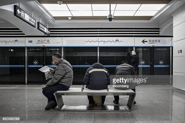 Commuters sit on a bench inside a subway station in Dalian China on Tuesday Jan 17 2017 Contrasting fortunes in Dalian illustrate Chinas transition...