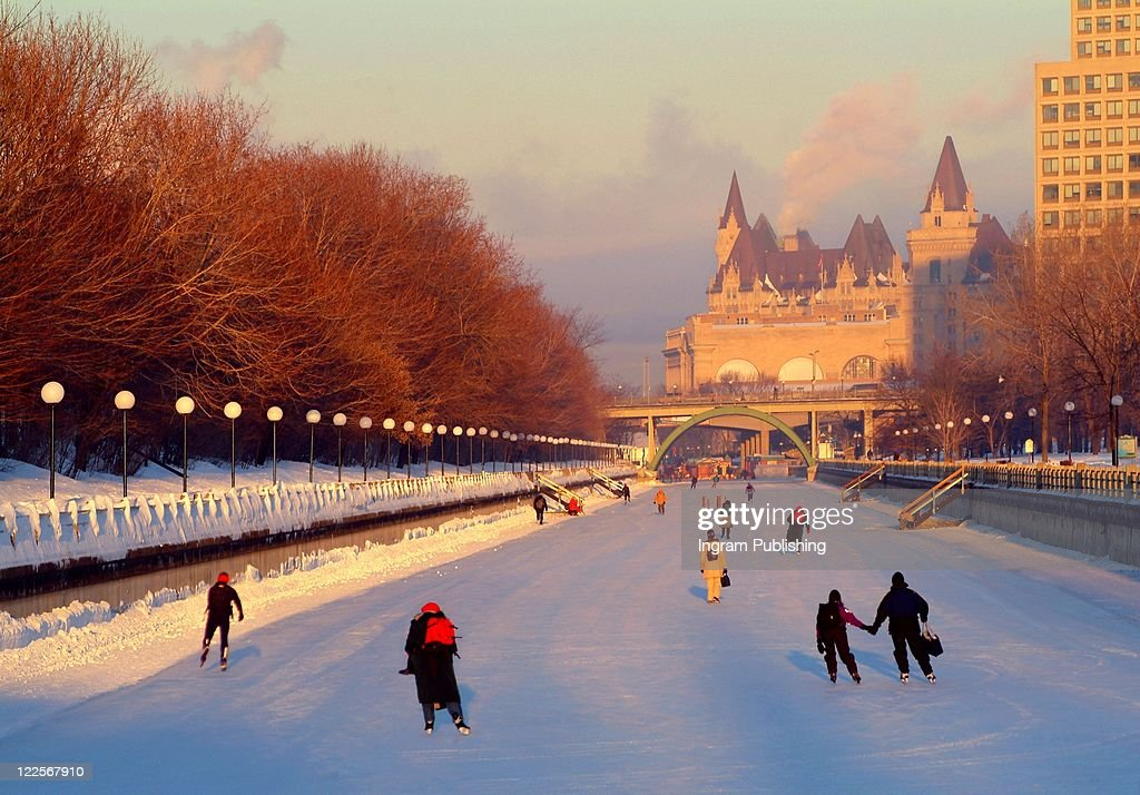 Commuters skating to work on the Rideau Canal, Ottawa Canada.