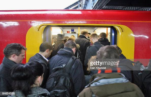 Commuters squeeze on to a train to Victoria Station at Clapham Junction on February 5 2009 in London England A recent report by London Assembly's...