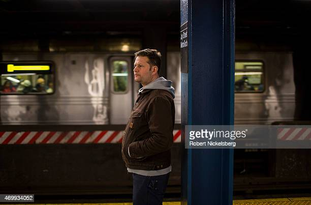 Commuters stand at the Jay Street Metro Tech station waiting for a Manhattan bound subway to arrive April 7 2015 in the Brooklyn borough of New York
