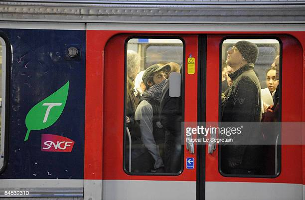 Commuters stand in a train at Paris Saint Lazare railway station on January 29 2009 in Paris France Commuters were disrupted throughout France's...