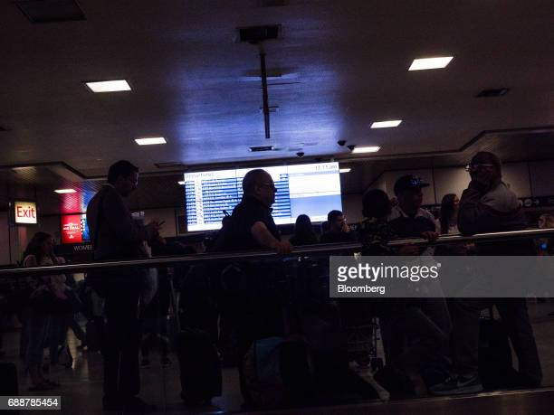 Commuters stand in front of the departure board inside Pennsylvania Station in New York US on Friday May 26 2017 PresidentDonald Trumptapped New...