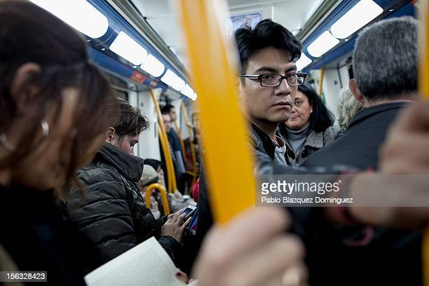 Commuters stand inside an underground train on November 13 2012 in Madrid Spain Spain's trade unions have called a general strike for November 14 the...