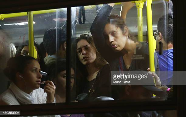 Commuters stand on a crowded bus during a tangled evening commute on June 9 2014 in Sao Paulo Brazil Metro workers have entered their fifth day of a...